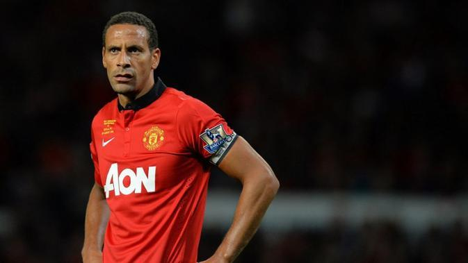 Rio Ferdinand memilih Sevilla sebagai lawan Manchester United pada laga testimonialnya yang berlangsung pada 2013. (AFP/Andrew Yates)