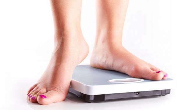 Ilustrasi berat badan. (iStock)