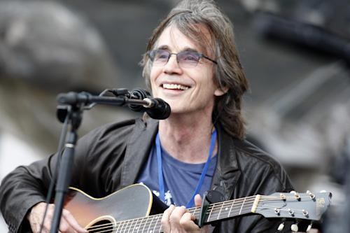 FILE - This July 29, 2012 file photo shows Jackson Browne performing at the Newport Folk Festival in Newport, R.I. Browne will perform at the Rock and Roll Hall of Fame induction ceremony on April 18 in Los Angeles. (AP Photo/Joe Giblin, file)