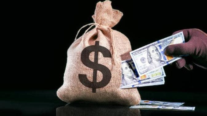 ilustrasi perampokan uang. (iStockphoto)