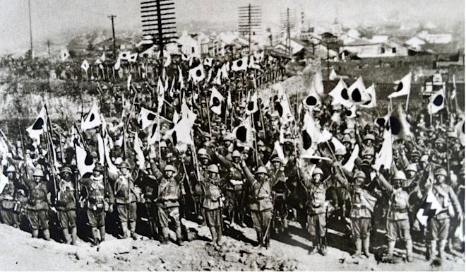 Japanese troops in Nanking after the city's conquest, in a print dated 1937. Photo: Universal Images Group via Getty
