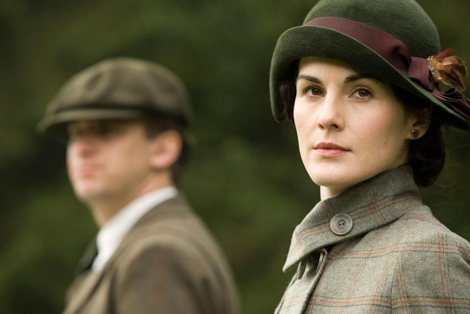 "FILE - In this file photo released by PBS, Dan Stevens as Matthew Crawley, left, and Michelle Dockery as Lady Mary are shown in a scene from the second season on ""Downton Abbey.""  The program was nominated for an Emmy award for outstanding drama series on Thursday, July 19, 2012. The 64th annual Primetime Emmy Awards will be presented Sept. 23 at the Nokia Theatre in Los Angeles, hosted by Jimmy Kimmel and airing live on ABC. (AP Photo/PBS, Carnival Film & Television Limited 2011 for MASTERPIECE, File)"