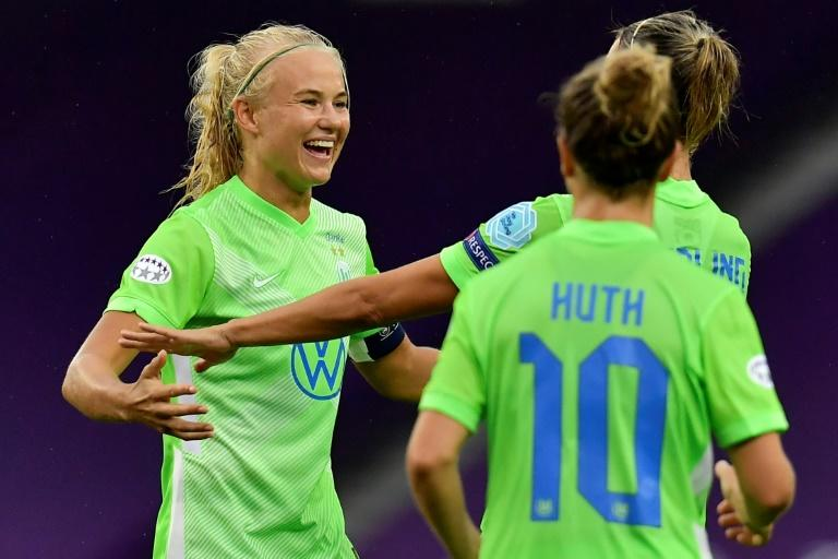 Nine-goal Wolfsburg into women's Champions League last four as Harder hits four