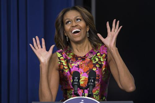 """First lady Michelle Obama reacts as she introduces the cast of """"The Trip to Bountiful"""" after a screening the movie, Monday, Feb. 24, 2014, in the South Court Auditorium on the White House complex in Washington. (AP Photo/ Evan Vucci)"""