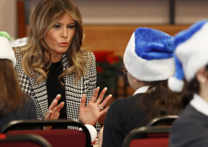 First lady Melania Trump joins local school students creating holiday decorations at the Salvation Army Clapton Center in London, Wednesday, Dec. 4, 2019. (AP Photo/Alastair Grant)