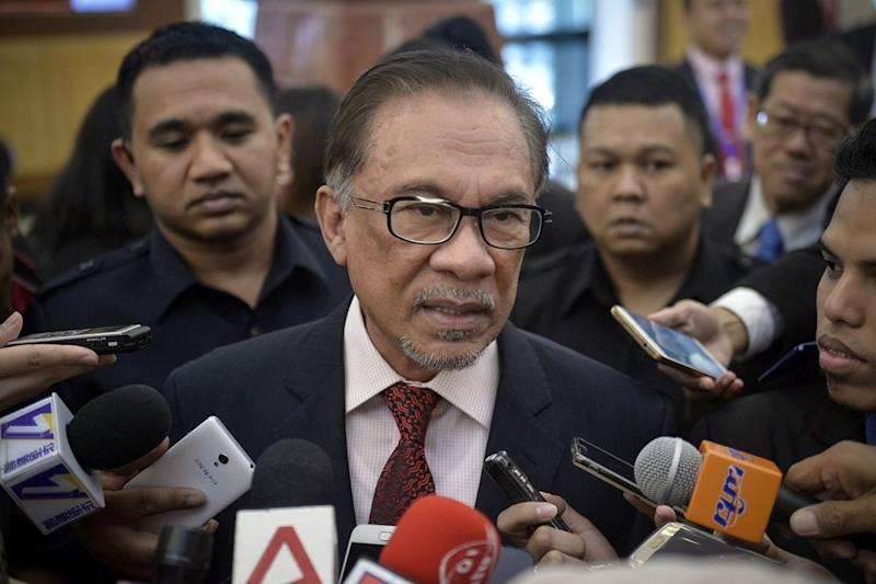 Datuk Seri Anwar Ibrahim speaks to the reporters at Parliament December 6, 2018. — Picture by Mukhriz Hazim