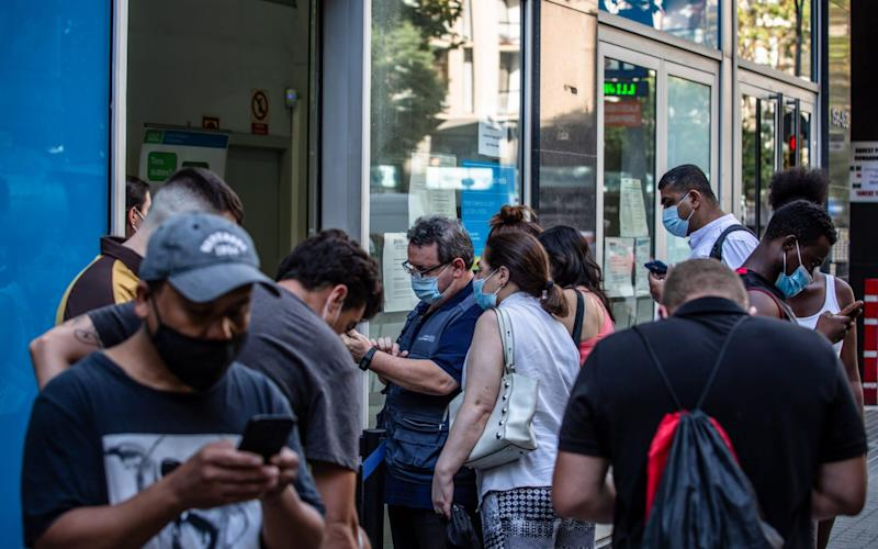 Job seekers gather outside a regional employment office in Barcelona, Spain, on Monday, Aug. 10, 2020 - Angel Garcia/Bloomberg