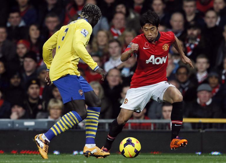 Arsenal's Sagna challenges Manchester United's Kagawa during their English Premier League soccer match in Manchester