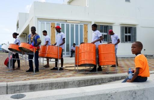 A steel drum band celebrated a Chinese-funded program to replace roofs ripped from more than 300 Barbuda homes by Hurricane Irma last September