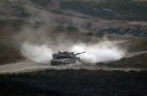 An Israeli army tank patrols along the border between Israel and the Gaza Strip on May 29, 2018