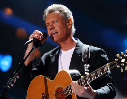 FILE - In this June 7, 2013 file photo, Randy Travis performs at the 2013 CMA Music Festival in Nashville Tenn. Travis is awake and making progress as he recovers from surgery following a stroke. A news release and video from the Texas hospital where the 54-year-old singer is recovering described Travis' condition Monday, July 15, and doctors gave a new cause for the health troubles _ scarring on his heart. (Photo by John Davisson/Invision/AP, File)