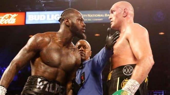 Pertarungan Tyson Fury (kenan) melawan Deontay Wilder