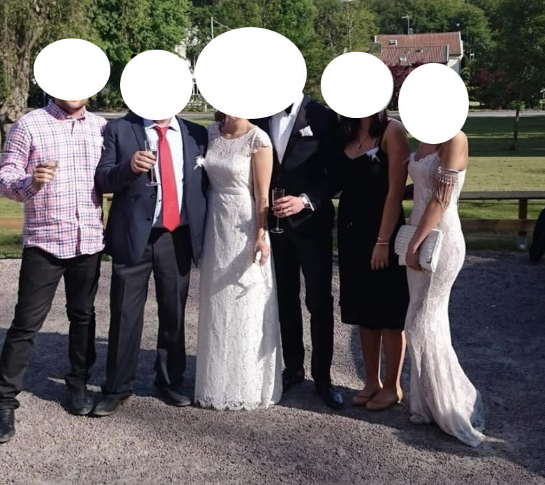 The guest (far right) upstaged the bride in a gown just as bridal as the woman of the moment. Photo: Facebook