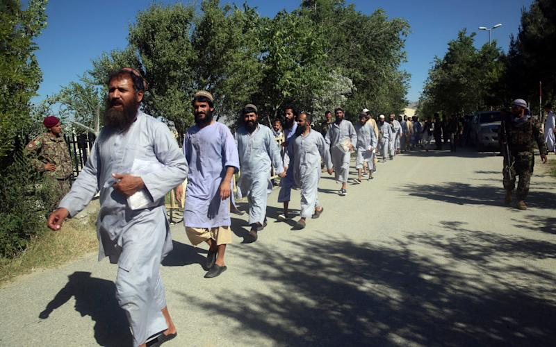 Afghan prisoners line up after their release from Bagram Prison in Parwan province, Afghanistan, Tuesday, May 26, 2020. - AFP