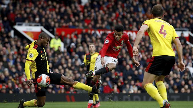 Striker Manchester United (MU) Mason Greenwood mencetak gol melawan Watford pada pekan ke-27 Liga Inggris di Old Trafford, Minggu (23/2/2020). MU menang 3-0. (Martin Rickett / PA via AP)