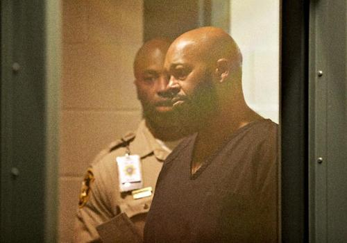 "FILE - In this Oct. 30, 2014 file photo, rap music mogul Marion ""Suge"" Knight appears in court on a traffic warrant, in Las Vegas following his arrest as a fugitive in a California robbery case. A lawyer for Knight says the Death Row Records founder was at the wheel of a car that struck two men, killing one, in a Los Angeles suburb. The accident in Compton occurred shortly before 3 p.m. Thursday, Jan. 29, 2015. (AP Photo/John Locher, File)"