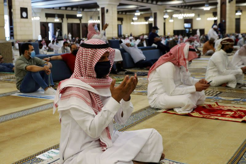 A Saudi man wearing a protective face mask performs the Friday prayers inside the Al-Rajhi Mosque, after the announcement of the easing of lockdown measures amid the coronavirus disease (COVID-19) outbreak, in Riyadh