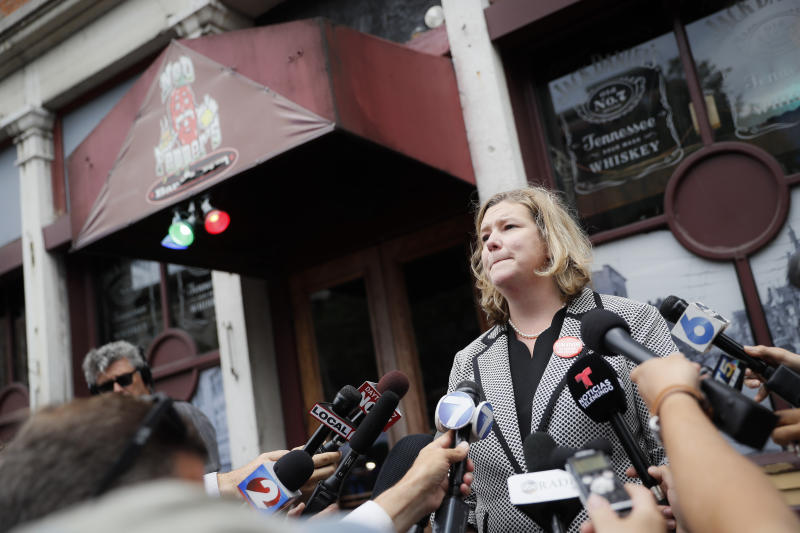 "FILE - In this Aug. 6, 2019 file photo, Dayton, Ohio, Mayor Nan Whaley speaks to members of the media outside Ned Peppers bar in the Oregon District after a mass shooting that occurred early Sunday morning in Dayton.  With a period of around 10 weeks, Dayton dealt with a Ku Klux Klan rally, a string of devastating tornadoes, and a mass shooting that killed nine people.  Whaley says those events reflect a lack on action on national issues of white supremacist activity, climate change and gun violence. Her end-of-the-year reflections include searing memories of the natural disaster and attack as she looks ahead to a year dedicated to ""healing and transformation."" (AP Photo/John Minchillo)"
