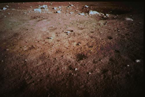 This Saturday Dec. 14, 2013 photo released by China's Xinhua News Agency, shows a picture of the moon surface taken by the on-board camera of the lunar probe Chang'e-3 on the screen of the Beijing Aerospace Control Center in Beijing, capital of China. China on Saturday successfully carried out the world's first soft landing of a space probe on the moon in nearly four decades, the next stage in an ambitious space program that aims to eventually put a Chinese astronaut on the moon. (AP Photo/Xinhua, Wang Jianmin) NO SALES