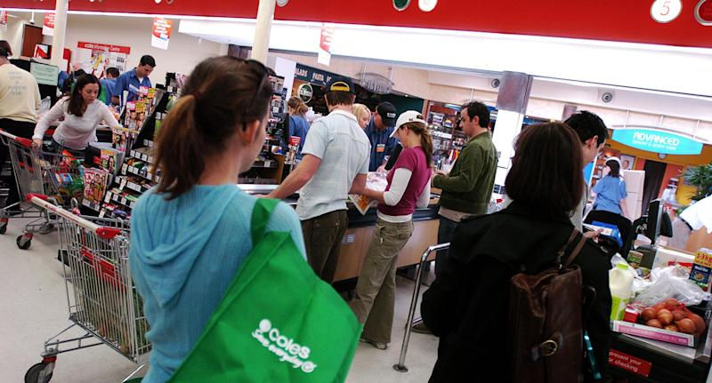 Shoppers lining up at Coles Supermarkets.
