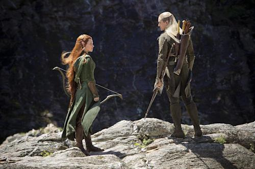 "This image released by Warner Bros. Pictures shows Evangeline Lilly, left, and Orlando Bloom in a scene from ""The Hobbit: The Desolation of Smaug."" (AP Photo/Warner Bros. Pictures, James Fisher)"
