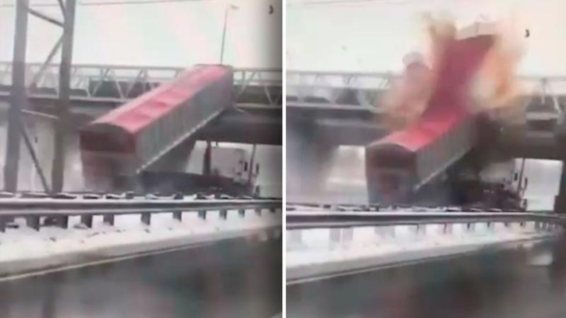 WATCH: Truck with raised trailer smashes into pedestrian bridge