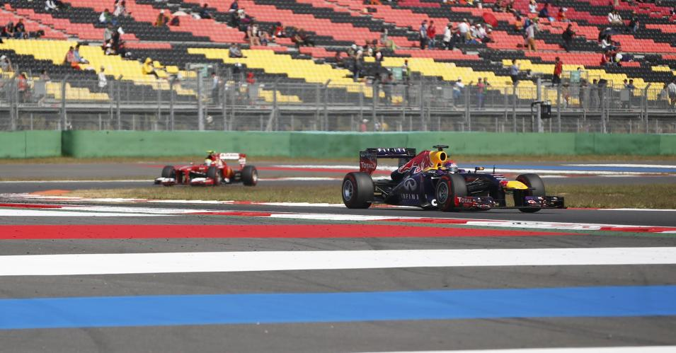 Red Bull Formula One driver Vettel races ahead of Ferrari Formula One driver Massa during the third practice session of the Korean F1 Grand Prix in Yeongam