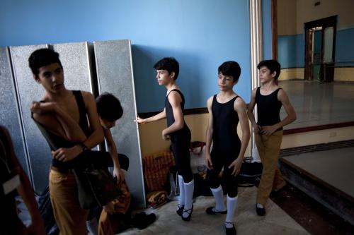 CORRECTING MARCO TO MARCOS - In this April 3, 2013 photo, identical triplets, from center left, Marcos, Cesar and Angel Ramirez Castellanos prepare for their ballet class at the National School of Ballet in Havana, Cuba. The 13-year-olds have already separated themselves from their peers technically and artistically, and all three have the talent to make a big splash in the ballet world when they grow up. If they succeed, they will join a long line of celebrated dancers trained in Cuba, where fans from every social stratum follow the careers of ballet stars like Carlos Acosta and Rolando Sarabia as closely as those of baseball players or boxers. (AP Photo/Ramon Espinosa)