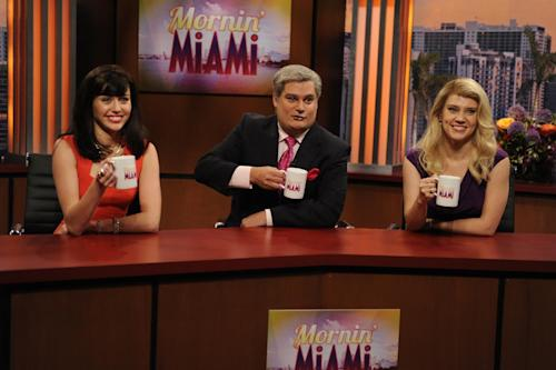 """This Oct. 5, 2013 photo released by NBC shows guest host Miley Cyrus, from left, Bobby Moynihan and Kate McKinnon in a scene from the late-night comedy series """"Saturday Night Live,"""" in New York. (AP Photo/NBC, Dana Edelson)"""