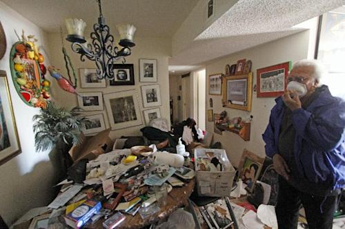Louis Ponce, brother-in-law of Bobbi Salinas-Norman, walks through the apartment on May 10, 2013, where he found Salinas-Norman dead. The remains of Salinas-Norman, a Chicana activist, teacher and author, were discovered last week and authorities say she may have been dead for more than a year. (AP Photo/The Santa Fe New Mexican,Luis Sanchez Saturno)