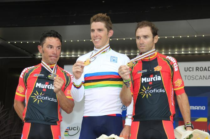 Tears on the podium for second-placed Joaquim Rodriguez (left) as Spanish national teammate Alejandro Valverde (right) remains unmoved