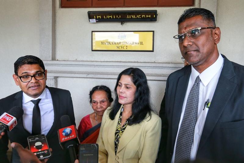 E. Meeriam Rosaline's lawyers Ramesh Sivakumar (left) and RSN Rayer (right) speak to members of the media at the Kuala Lumpur High Court February 18, 2020. — Picture by Ahmad Zamzahuri