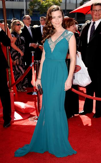 Linda Cardellini arrives at the 2013 Primetime Creative Arts Emmy Awards, on Sunday, September 15, 2013 at Nokia Theatre L.A. Live, in Los Angeles, Calif. (Photo by Scott Kirkland/Invision for Academy of Television Arts & Sciences/AP Images)