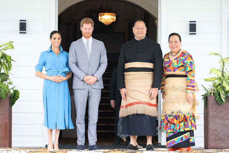 NUKU'ALOFA, TONGA - OCTOBER 26: Prince Harry, Duke of Sussex and Meghan, Duchess of Sussex Standing with King Tupou VI and Queen NanasipauÔu TukuÔaho of Tonga at the farewell with His Majesty King Tupou VI on October 26, 2018 in Nuku'alofa, Tonga. The Duke and Duchess of Sussex are on their official 16-day Autumn tour visiting cities in Australia, Fiji, Tonga and New Zealand. (Photo by PhotographerÕs Name Ð Pool/Getty Images)