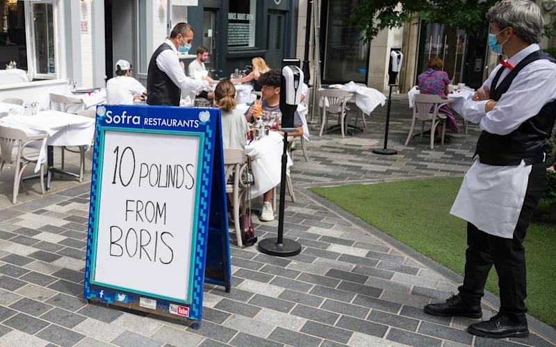 A London restaurant advertises its participation in the Eat Out To Help Out scheme - Leon Neal/Getty Images