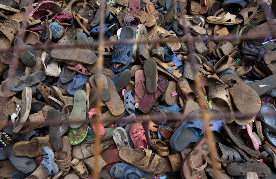 In this photo taken Monday, April 29, 2013, a pile of discarded flip-flops sits in a crate ready to be washed, sorted, and carved into toy animals, at the Ocean Sole flip-flop recycling company in Nairobi, Kenya. The company is cleaning the East African country's beaches of used, washed-up flip-flops and the dirty pieces of rubber that were once cruising the Indian Ocean's currents are now being turned into colorful handmade giraffes, elephants and other toy animals. (AP Photo/Ben Curtis)