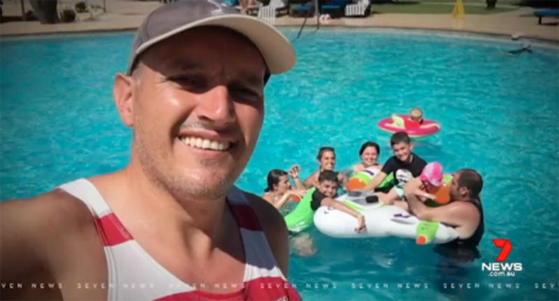 Pictured is Melbourne dad Adrian Nandapi and his family swimming in a Fiji pool where he scraped his leg that became seriously infected.