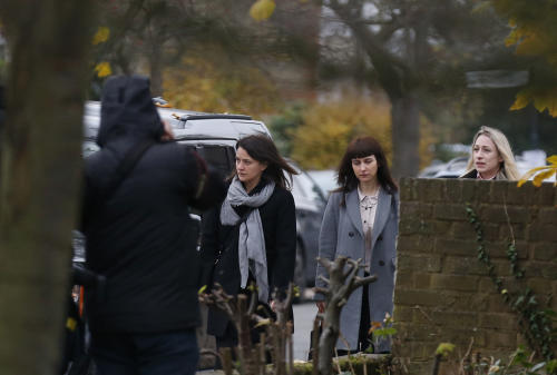 Francesca Grillo, center right, and Elisabetta Grillo, center left, arrive at Isleworth Crown Court in London, Wednesday, Dec. 4, 2013. Celebrity chef Nigella Lawson could face questions Wednesday about alleged drug use when she appears as a witness at the fraud trial of her former personal assistants. Lawson is due to testify as a prosecution witness against Italian sisters Elisabetta and Francesca Grillo. The pair are accused of living the high life by using credit cards loaned to them by Lawson and her ex-husband Charles Saatchi. (AP Photo/Sang Tan)