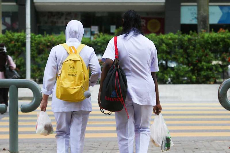 Nurses go home after working the night shift at the KL Hospital April 2, 2020. ― Picture by Choo Choy May