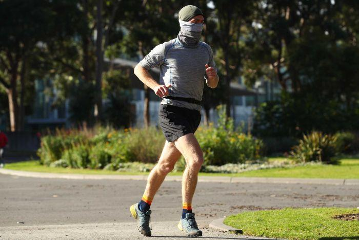 A man running in Melbourne's Carlton Gardens on July 16