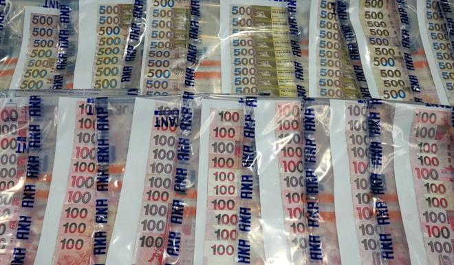 Police seized about HK$115,000 during Operation Stepshadow. Photo: Handout