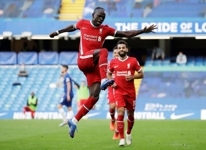 Mane double eases Liverpool to 2-0 win over 10-man Chelsea