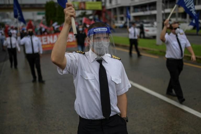 Airline workers join a protest in Panama against government measures to reopen the economy