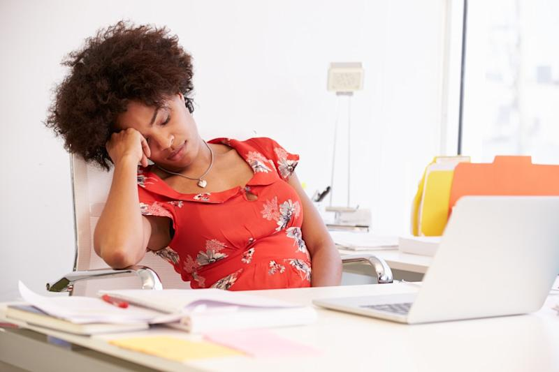 woman sleeping at her desk