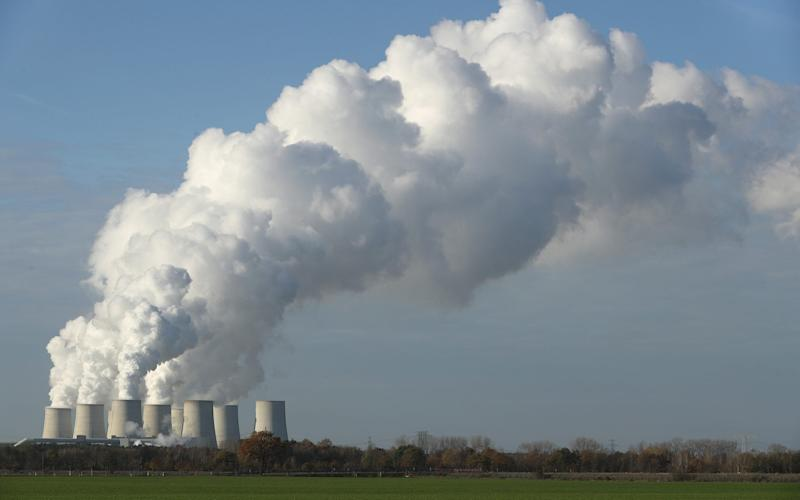 Steam rises from the cooling towers of the Jaenschwalde coal-fired power plant - Sean Gallup/Getty Images Europe