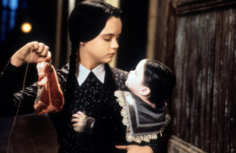Christina Ricci dangling meat in a scene from the film 'Addams Family Values', 1993. (Photo by Paramount/Getty Images)