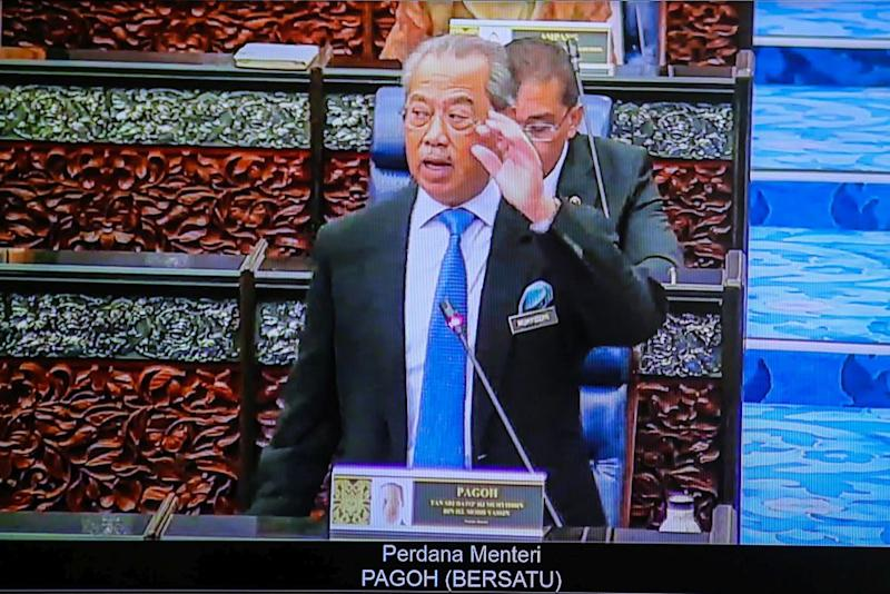 Prime Minister Tan Sri Muhyiddin Yassin delivers his speech during the second meeting of the third session of the 14th Parliament during a live broadcast in Kuala Lumpur July 13, 2020. — Picture by Hari Anggara