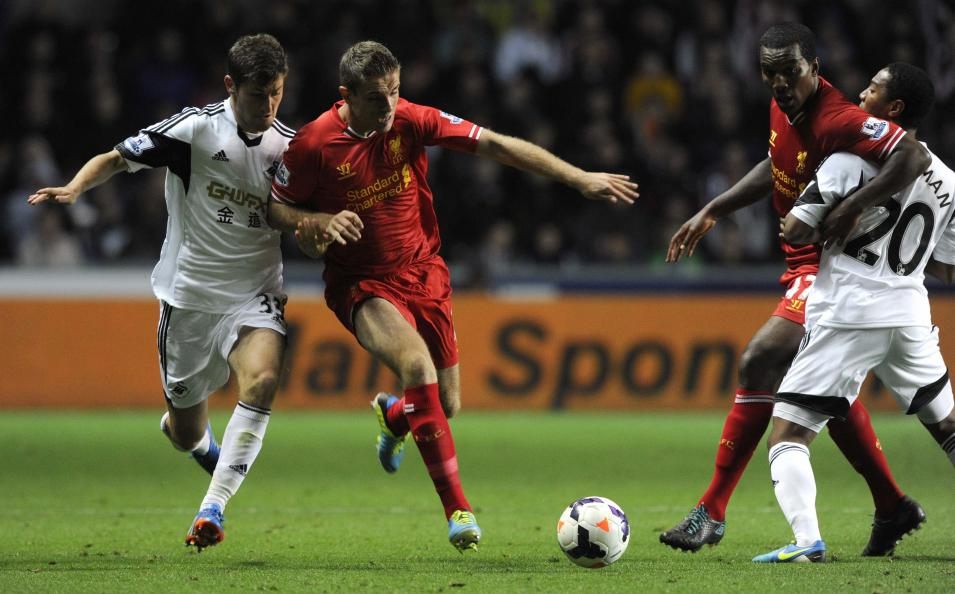 Swansea City's Davies challenges Liverpool's Henderson during their English Premier League soccer match in Swansea