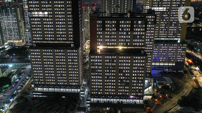 Foto udara memperlihatkan suasana Rumah Sakit Darurat Wisma Atlet, Kemayoran, Jakarta, Kamis (10/9/2020). Sebanyak 1.600 tempat tidur yang dipersiapkan pemerintah untuk pasien COVID-19 di Rumah Sakit Darurat Wisma Atlet telah terisi. (Liputan6.com/Faizal Fanani)