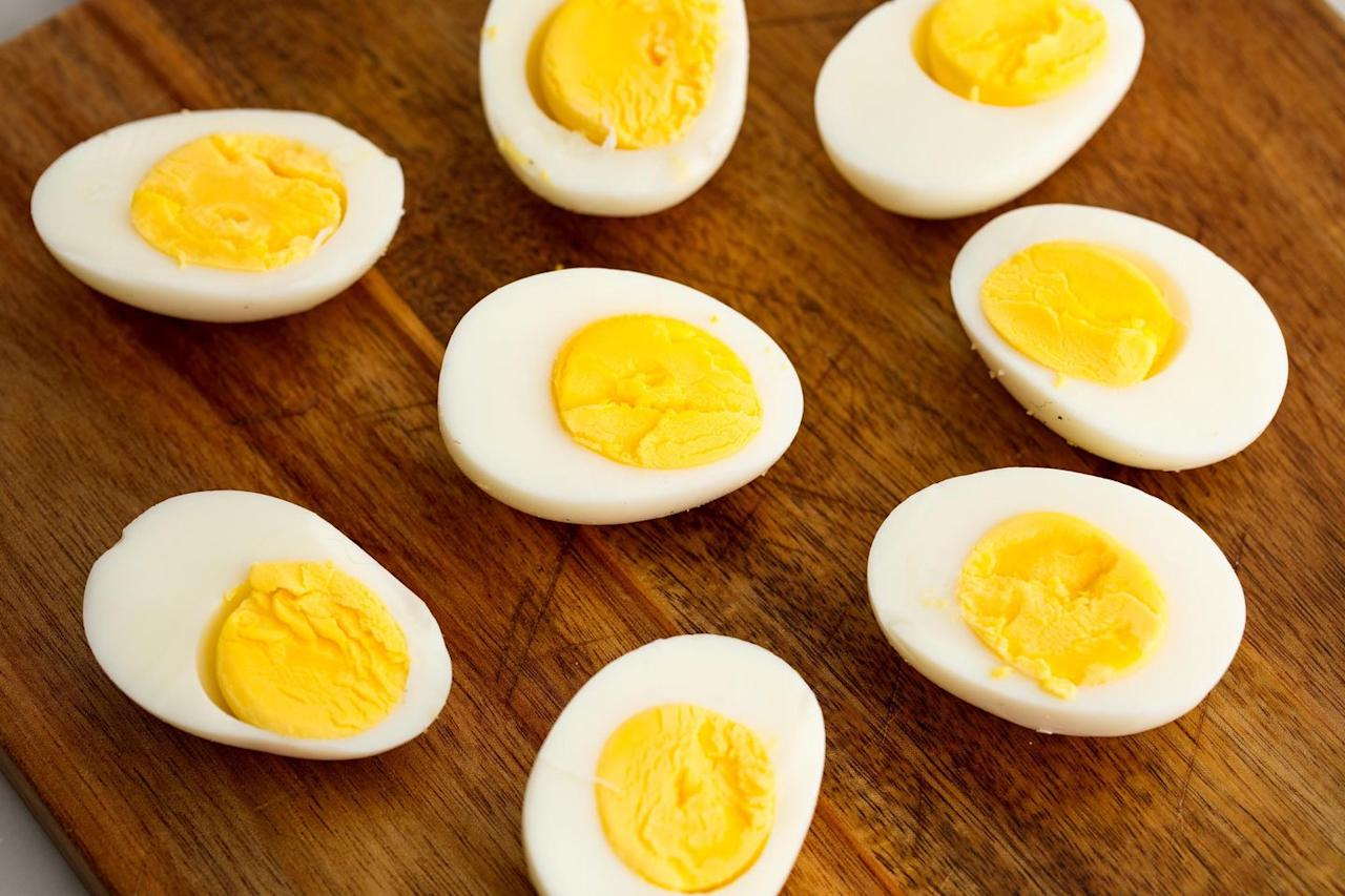 """<p>This might be one of the best bang for your buck foods to tote. <a href=""""https://www.delish.com/cooking/recipe-ideas/recipes/a58284/how-to-make-perfect-hard-boiled-eggs/"""" target=""""_blank"""">Hard boiled eggs are simple to make</a>, filling, and easy to rinse off if they happen to encounter an impromptu sand storm. They're also delicious warm or cold if cooler space is an issue. Just peel them in advance—it's way too much work to do it on the beach.</p>"""